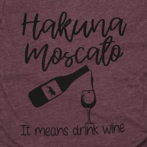 HAKUNA MOSCATO - IT MEANS DRINK WINE - Short Sleeve Boutique Graphic Tee. These t-shirts are sold in a 6 pack. S:1 M:2 L:2 XL:1 52% Cotton and 48% Polyester Brand: Bella Canvas