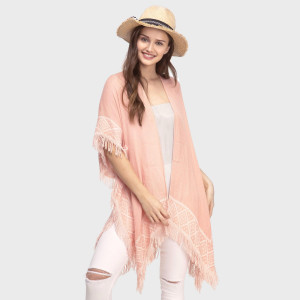 Lightweight, short sleeve kimono with embroidery and fringe accents. 50% viscose and 50% acrylic. One size fits most.