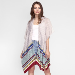 Lightweight, short sleeve kimono with an abstract print. 100% polyester. One size fits most.