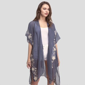 Lightweight, short sleeve kimono with floral embroidery and pearl accent. 35% viscose and 65% polyester.