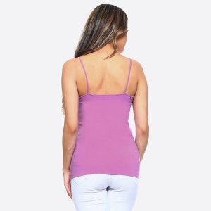 The summer must have is here! This sexy cami top features spaghetti straps, solid color, sleeveless and crisscross design. Wear this top with distressed shorts and take on Summer in style!   • Scoop-neck  • Unique Crisscross Front  • Spaghetti Straps  • Ultra Soft  • Stretchy Knit  • Machine Wash  • Imported   One size fits most 0-14.  Content: 92% Nylon, 8% Spandex