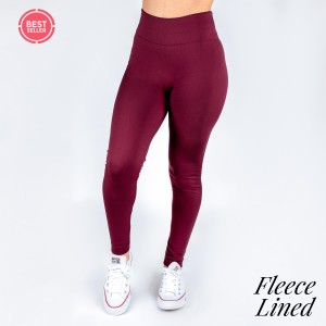 Burgundy fleece lined leggings. One size fits most, full length, winter weight. Offered in everyday essential colors to coordinate with long tops, skirts, or to wear underneath clothing to keep warm. Made of a 92% polyester and 8% Spandex mix.