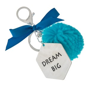 """Silver tone key chain or bag charm stamped with """"Dream Big"""" and a blue pom pom. Approximately 5.5"""" in length."""