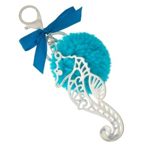 """Silver tone key chain or bag charm stamped with a seahorse pendant and a blue pom pom. Approximately 5.5"""" in length."""