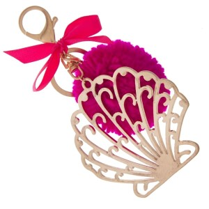 """Gold tone key chain or bag charm stamped with a seashell pendant and a fuchsia pom pom. Approximately 5.5"""" in length."""