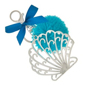 """Silver tone key chain or bag charm stamped with a seashell pendant and a blue pom pom. Approximately 5.5"""" in length."""