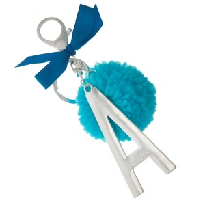 """Silver tone key chain or bag charm with a block 'A' initial pendant and blue pom pom. Approximately 5.5"""" in length."""