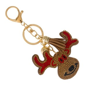 Gold tone keychain and bag charm with a reindeer.