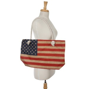 """American flag tote bag with a top zipper. 45% polyester and 55% cotton. Measures 20"""" x 12"""" in size with a 10"""" handle drop."""