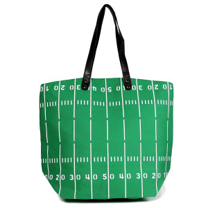 """Football field tote bag is perfect for tailgating and monogramming. This bag features a snap closure, lined interior and interior pockets. 16"""" x 19"""" in size with a 10"""" handle drop. 80% cotton and 20% polyester."""