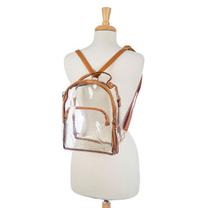 "Clear PVC handbag perfect for GAMEDAY! This bag can be worn as a crossbody bag or a backpack and has two pockets. Measures 9"" x 11"" x 5"" in size."