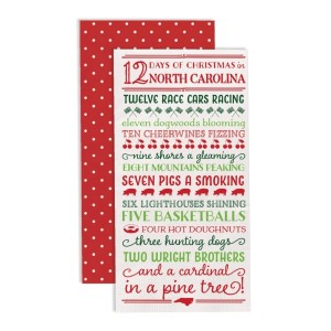 """""""12 Days of Christmas in North Carolina"""" guest napkins are two-ply and feature a polka dot print on the back. Measures approximately 4.5"""" x 8"""" when folded and comes 16 napkins to a pack. All artwork and lyrics are copyrighted."""
