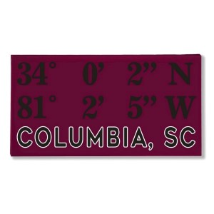 "Canvas wall art with the coordinates of Columbia, SC in your team colors to show your school pride. Canvas measures 10"" x 1.5"" x 19."""