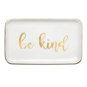 "White ceramic trinket tray featuring ""Be Kind"" and trimmed in gold. Measures approximately 6.5"" x 4"" in size."