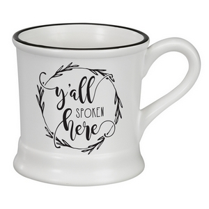 "White ceramic mug that says ""Y'all Spoken Here"" and hold 14 ounces."