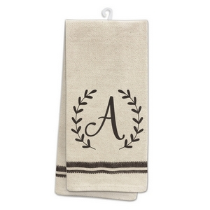 "Tan tea towel featuring a script 'A' initial printed on both sides. 100% cotton. Measures 25"" x 19"" when open."