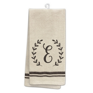 "Tan tea towel featuring a script 'E' initial printed on both sides. 100% cotton. Measures 25"" x 19"" when open."