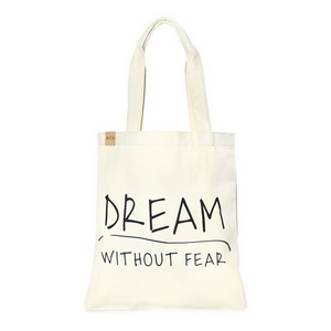 """Canvas tote bag with an inside pocket and """"Dream Without Fear"""" on the front. 100% cotton. Measures approximately 17"""" x 14"""" in size with an 11"""" handle drop."""