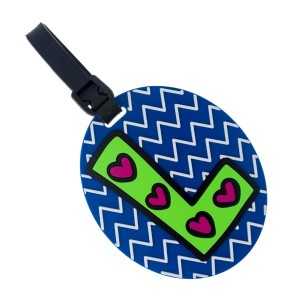 Rubber luggage tag with name and address card, with the 'L' initial.