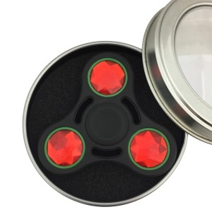 Black and red heavy metal fidget spinner. Packaged in a round tin can. Allows you to spin stress away, and can even help some people focus! Ceramic ball bearings allow for long spin times.