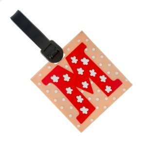Rubber luggage tag with name and address card, with the 'M' initial.