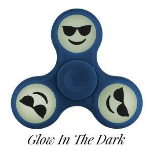 Blue Glow in the Dark fidget spinner featuring a smiley face emoji with shades. Allows you to spin stress away, and can even help some people focus! Ceramic ball bearings allow for long spin times.