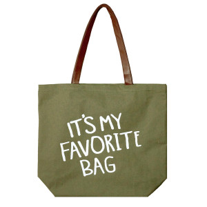 """Canvas tote bag with """"It's my favorite bag"""" printed on the front, a flat bottom and faux leather handles. Measures 18"""" x 12"""" with a 9"""" shoulder drop."""