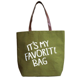 "Canvas tote bag with ""It's my favorite bag"" printed on the front, a flat bottom and faux leather handles. Measures 18"" x 12"" with a 9"" shoulder drop."