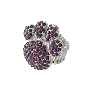 Silver tone stretch band ring with paw print covered in purple rhinestones.