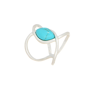 Size 4 Worn silver tone knuckle style ring featuring a turquoise tone cabochon.