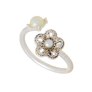 Silver tone adjustable ring featuring a flower at the opening with faux ivory pearl accents. One size fits most.