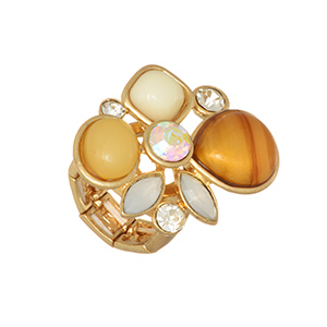 Gold tone stretch ring featuring a cluster of brown, nude, and ivory cabochons with rhinestone accents.
