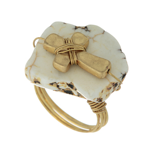 Gold tone wire wrapped ring featuring a beige stone with a cross focal. Size 7 only.