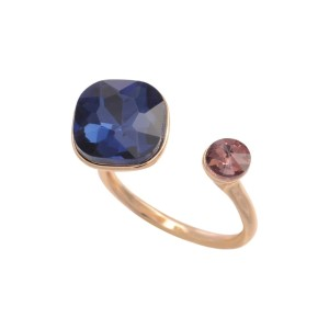 Gold tone adjustable ring with a navy blue and pink rhinestone.