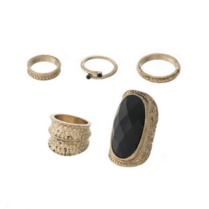 Burnished gold tone, one size ring set with a black faceted stone. Includes five rings.