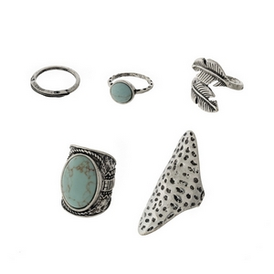 Burnished silver tone ring set with five rings and turquoise stones.