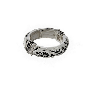 Silver tone stretch ring with a designer texture, accented with clear rhinestones.