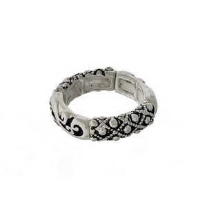 Silver tone stretch ring with a designer texture.