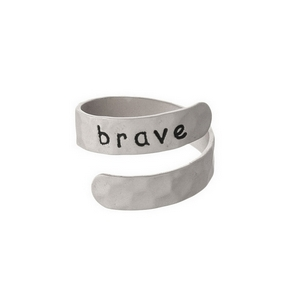 "Hammered silver tone, adjustable ring stamped with ""Brave."""