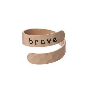 "Hammered copper tone, adjustable ring stamped with ""brave."""
