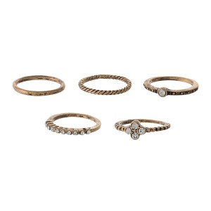 Burnished gold tone five piece ring set with mixed textures and clear rhinestones. One size - size 6.