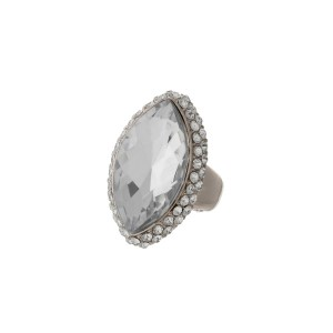 Silver tone stretch ring with a clear oval faceted stone.
