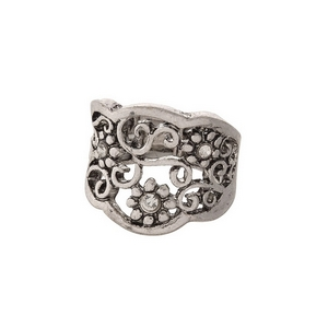 Burnished silver tone, stretch ring with a floral pattern, accented by clear rhinestones.