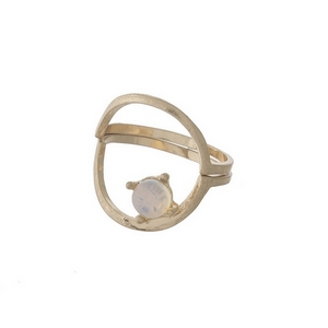 Dainty gold tone, two piece ring with an opal stone. Approximately a size 7.