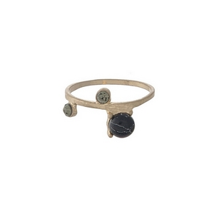 Gold tone ring with a black stone, accented by rhinestones. Approximately a size 7.