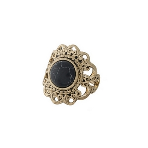 Gold tone scalloped ring with a black stone focal. One size - approximately a size 7.