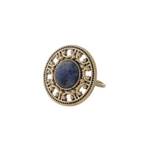 Gold tone ring with a blue stone focal. One size - approximately a size 7.