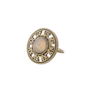 Gold tone ring with a white opal stone focal. One size - approximately a size 7.
