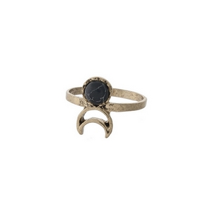 Gold tone ring with a black stone and a cutout crescent. Approximately a size 7.