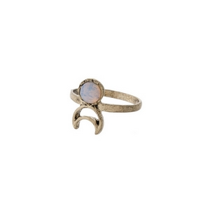 Gold tone ring with an opal stone and a cutout crescent. Approximately a size 7.